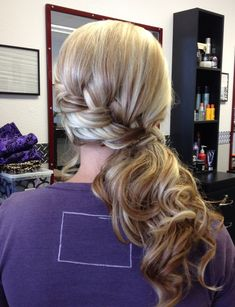 Side Hair braid with a low pony...but I would put the pony into a curly bun