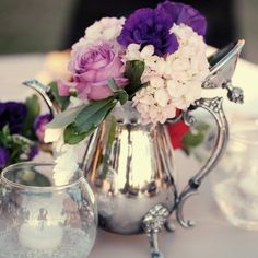 100 Ideas for Spring Weddings Centerpieces Place seasonal blooms in antique silver vessels for a charming DIY centerpiece.