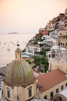 The view from the famed Le Sirenuse hotel in Positano... and ALSO the view from our very own Villa Santa (sleeps 6) located just below the hotel! Visit RentVillas.com for more details.
