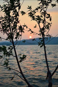 Sunset on the West Lake. #China #Hangzhou #lake #landscape #light #silhouette #sunset #trees #water #nature
