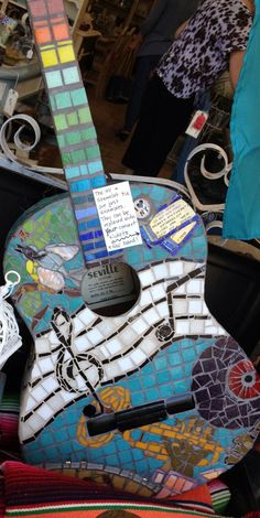 Guitar covered in glass mosaics