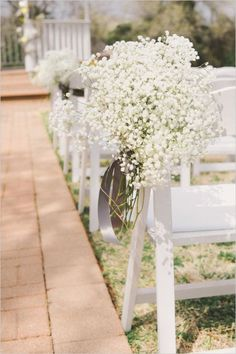 babys breath hanging from chairs at ceremony / http://www.deerpearlflowers.com/rustic-budget-friendly-gypsophila-babys-breath-wedding-ideas/4/