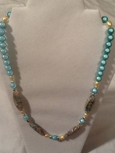 Hey, I found this really awesome Etsy listing at https://www.etsy.com/listing/191796644/pale-blue-and-pearl-summer-necklace