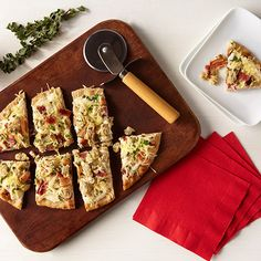 White Clam Flatbread with Herbs combines tender Chicken of the Sea® Whole Baby Clams, crispy bacon, and a creamy sauce to create the perfect combo for a tasty appetizer or satisfying lunch.