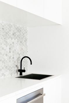 CM Studio Cross Street Project - love the splashback tile and the black tapware and White benchtop
