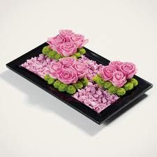 plain and simple tray filled with pink rocks and decorative flowers