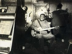 """David 'Junior' Kimbrough inside his juke joint. Kimbrough ran own parties and jukejoints, developing distinctive style through long nightly jams. In an interview from the 1990: Junior said : """"I have a different type of music from other peoples. They playing the other kind of blues, and I'm playing cotton-patch blues… Ain't nobody now can play the blues that I play."""""""
