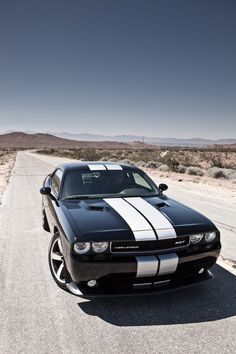 2012 Dodge Challenger SRT. Drove one of these the other day.. Let's just say this thing is a nuclear powered dinosaur :)