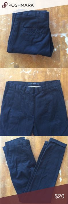 """Zara black tapered trousers Excellent condition cotton/elastane trousers with dart details down the front. Front slant pockets and back welt pockets. Cuffed hem and slim waistband, but the belt loops are normal size. Waist laid flat 13.75"""", rise 9.25"""", inseam 27.5"""" Zara Pants Ankle & Cropped"""