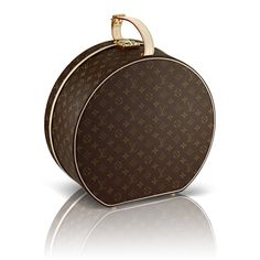 Hat Box via Louis Vuitton.  Travel luggage doesn't get much more elegant than this.