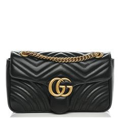 6754a9b69a98b This is an authentic GUCCI Calfskin Matelasse Small GG Marmont Shoulder Bag  in Black. This