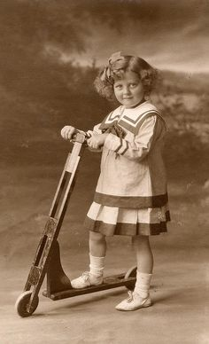 Alicia Maud Jenkins in sailor dress with her scooter, 1917