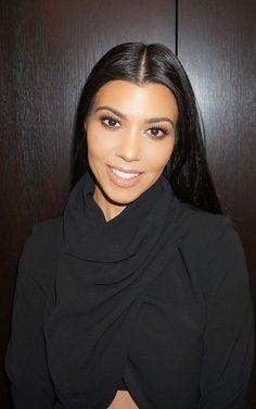 Who made  Kourtney Kardashian's black turtleneck wrap top?