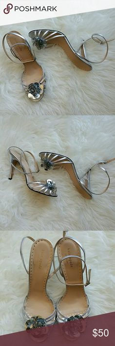 Kate Spade silver flower power Silver sandals with flower detail at toes. Super strappy, super sexy! Great condition. Kate Spade Shoes Heels