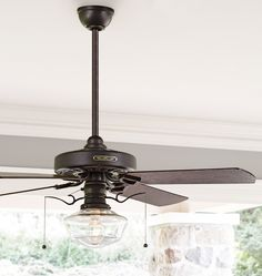 """The Heron Ceiling Fan & Light Kit is based on G.E. ceiling fans built between 1913-1925. It features a cast motor housing for stability and reduced sound, along with oak plywood fan blades pitched at 14 degrees to move air efficiently and effectively. This fan includes a 10.5"""" Clear Ogee Schoolhouse Shade and a pull-chain extender, based on a 1912 design, that prevents the shade from scratching.    * Cast iron, ABS (Fumed Oak) or wood (Fumed Maple) blades * Reversible AC induction motor…"""