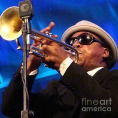 Roy Hargrove playing live of a trumpet or horn on stage at a jazz festival in Toronto.Buy prints at eva-kato,artistwebsites.com