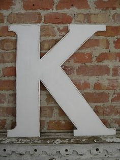 Use the married initial and have all guests sign, hang in your hallway or in the entryway of your home.
