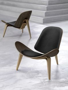 The Carl Hansen Shell Chair By Hans Wegner Oozes Style And Elegance.  Classic Chair Styling This Modern Designer Chair Available Is Several  Finishes.