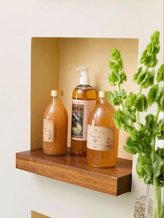 In a small bath, carving out creative storage space is paramount. Niches were built between the sink wall's studs to accommodate small storage. Thick wooden bases extend the niche area with a modern touch that keeps with the bath's organic aesthetic. Bathroom Niche, Wooden Bathroom, Bathroom Shelves, Bathroom Organization, Bathroom Storage, Bathroom Ideas, Master Bathroom, Natural Bathroom, Shower Ideas