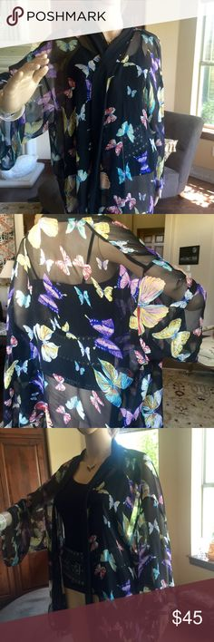 Butterfly silk kimono style top Pure silk.  29 inches from neck to hem S- M.  No size listed but I think S - M not L.  Gently worn.  Vivid butterfly colors on black background.  Whisper thin.   Double black trim around neck and front sides. CH Cacoon House Tops