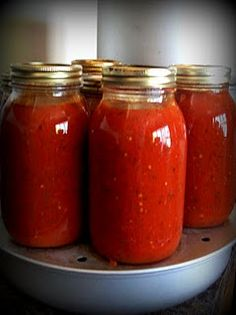 Spaghetti Sauce ~ I have tried several different spaghetti sauce recipes and always come back to this.  We love it and it looks so pretty in the jars.  (The Farm Girl)