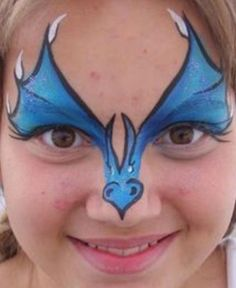 Simple face painting designs are not hard. Many people think that in order to have a great face painting creation, they have to use complex designs, rather then simple face painting designs. Dinosaur Face Painting, Dragon Face Painting, Face Painting For Boys, Simple Face Painting, Easy Face Painting Designs, Facial Painting, Body Painting, Tinta Facial, Dragon Makeup