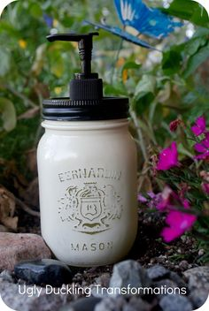 Beautiful painted & distressed mason jar soap dispensers. She did such a great job on these.   Via: Ugly Duckling Transformations