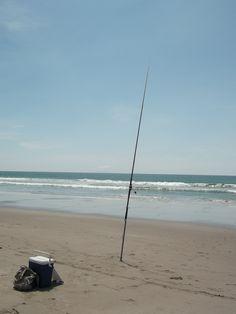 Fishing at Papamoa Beach, New Zealand