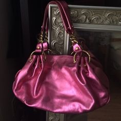 Juicy Couture Pink Handbag Gorgeous Juicy Couture metallic pink handbag!  Very spacious on the inside with nice tan lining.  Pockets with magnetic closure on both sides.  This purse is well made and genuine leather! Beautiful and in Excellent condition. Juicy Couture Bags Shoulder Bags