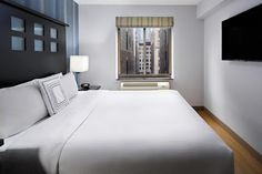 The non-smoking Fairfield Inn Manhattan offers bright rooms with cable flat-screen TV and work desk, just one block from Broadway. Rooms are accessible by elevator and fitness equipment is available.  All air-conditioned rooms feature a seating area, coffee maker and private bathroom with hairdryer. A daily housekeeping service is included at the Fairfield Inn & Suites New York Manhattan/Chelsea.#cheaphotelhacks #cheaphotelhowtoget #cheaphotelwebsites #cheaphoteldeals #cheaphotelinvegas # Cheap Hotel Websites, Cheap Hotels, Fairfield Inn, Bright Rooms, Work Desk, Fitness Equipment, Elevator, Housekeeping, Manhattan