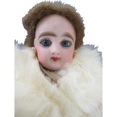 Today we are offering this extremely pretty antique FG fashion bisque head doll.  She measures only 12 tall and has a stunning face.   She is marked