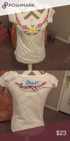 Guess Top Guess Top  Bohemian Top  tag says Large I think more of a Medium. White pink green yellow. Beautiful top lots of compliments. Cap sleeves   100% Cotton. Guess Tops Blouses
