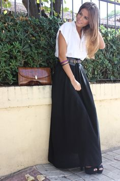 white button up blouse, thick belt and black maxi skirt