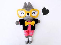 Leopold,  the retro raccoon plush with big yellow glasses. €58.00, via Etsy.