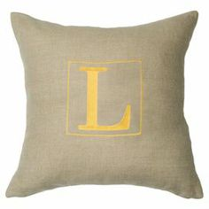 """Bring personalized style to your sofa, chaise, or bed with this charming linen pillow, showcasing a block letter initial in bright yellow.  Product: PillowConstruction Material: Linen coverColor: Yellow and naturalFeatures:  Insert includedPersonalize with your initialDimensions: 22"""" x 22""""Cleaning and Care: Dry clean only"""