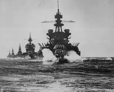 """USS PENNSYLVANIA and battleship of COLORADO class followed by three cruisers move in line into Lingayen Gulf preceding the landing on Luzon."""" Philippines, January 1945"""