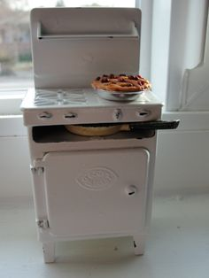 my vintage miniature crescent stove with a tiny cherry pie made by me!