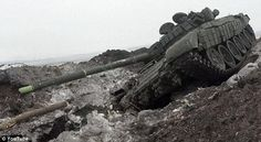 Here a Ukrainian tank lies damaged and unused in the battleground near Debaltseve. The Ukr...