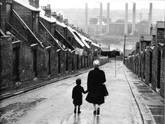 "Hey kid, you wanna see some pictures? A woman and child walking down a Tyneside street, in Newcastle, England, 1950 From Bert Hardy/Getty Images "" Vintage Photography, Street Photography, Travel Photography, Old Photos, Vintage Photos, Old Street, Documentary Photography, British History, Black And White Photography"