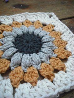 Sunburst Granny Square. I love the puff stitch round! Good idea!