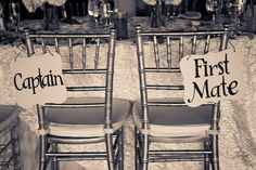 Captain and First Mate signs for the bride and groom's chairs... but who sits where??