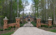 Look how a straight driveway design can be stunning. Entry columns, pavers (would even be nice without them), curbing and a beautiful, natural landscape design makes this all work nicely. See more driveway ideas. Driveway Entrance Landscaping, Driveway Design, Driveway Gate, Backyard Landscaping, Luxury Landscaping, Landscaping Ideas, Stone Driveway, Circular Driveway, Brick Columns Driveway