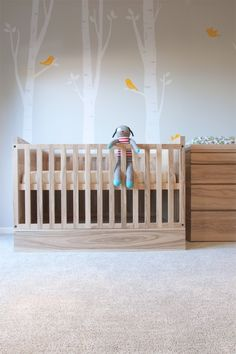 This modern crib is softened by the exposed wood grain and the addition of birch tree decals with cute birds. Owl Themed Nursery, Elephant Nursery, Nursery Decor, Wood Nursery, Woodland Nursery, Custom Furniture, Kids Furniture, Chic Baby Rooms, Modern Crib