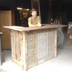 Custom counter built by Luke...made of 1880's French doors, shutters and teak trim.