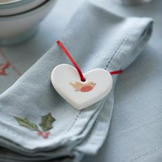 These ceramic heart decorations are hand painted with a robin and have a red tie. Christmas Hearts, Christmas Plates, Christmas Holidays, Heart Decorations, Christmas Decorations, Table Decorations, Susie Watson, Table Linens, Linen Bedding