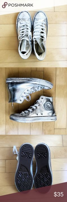 Converse Silver All Star Hi-Top Sneakers Silver shiny leather upper. Paint splash effect on the edge of sole which is really cool. Barely worn like new. Comes with original shoe box. Converse Shoes Sneakers