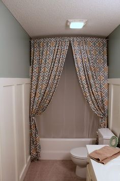 notice shower curtains are hung right up to the ceiling-makes the bathroom seem bigger-great idea!