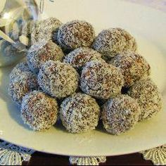 Chocolate Coconut Balls @ allrecipes.com.au should be an easy one to do with the kids. I remember making these when I was a kid and getting sick from so much sampling and can licking