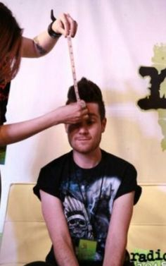 Are they measuring his hair? Haha Dan Smith from Bastille /// save him