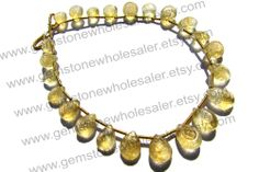 https://www.etsy.com/in-en/listing/185955348/citrine-faceted-carved-pear-quality-a-18?ref=shop_home_active_14&ga_search_query=Citrine
